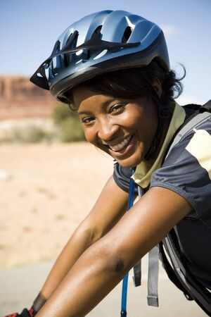 Female Cyclist With Helmet Outdoors Smiling LANG_EVOIMAGES