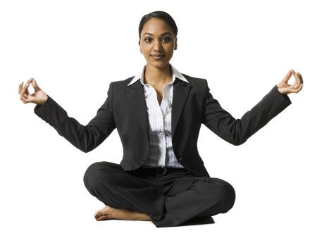 Businesswoman Sitting Cross Legged Doing Yoga LANG_EVOIMAGES