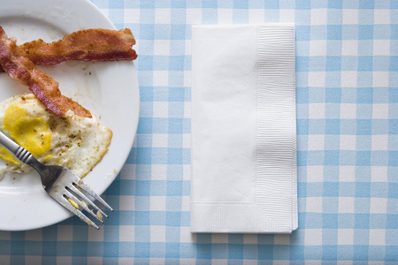 Bacon And Eggs With Orange Juice Fork And Napkin