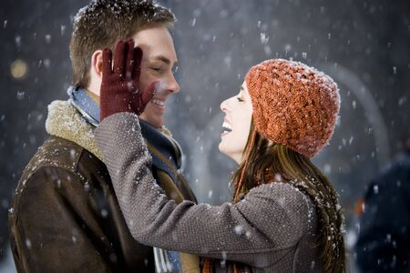 Man And Woman Outdoors In Winter Smiling LANG_EVOIMAGES