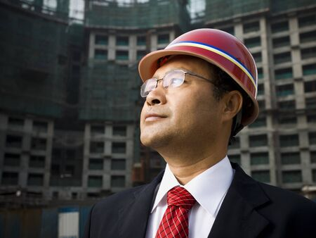 Businessman With Construction Helmet Outdoors LANG_EVOIMAGES