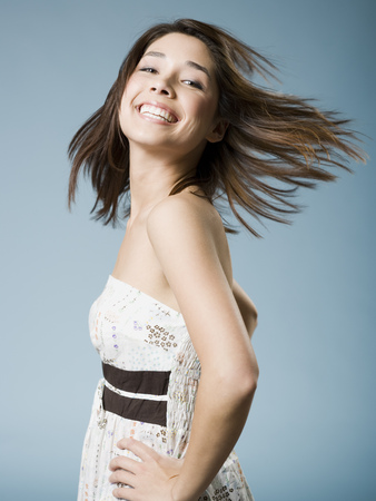 Woman Tossing Hair And Smiling
