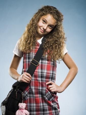 Schoolgirl Standing With School Bag Smiling