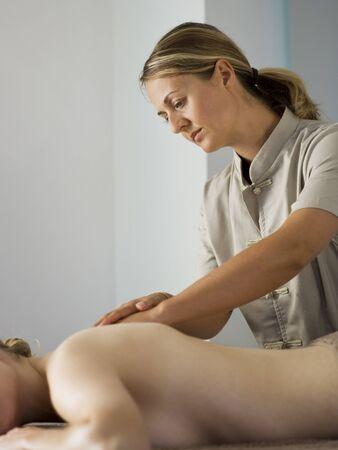 Woman Massaging Female