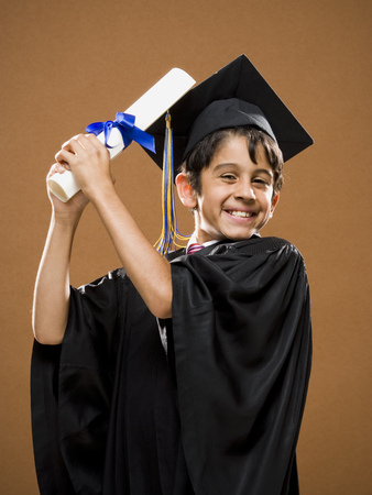 Boy Graduate With Mortar Board And Diploma Smiling