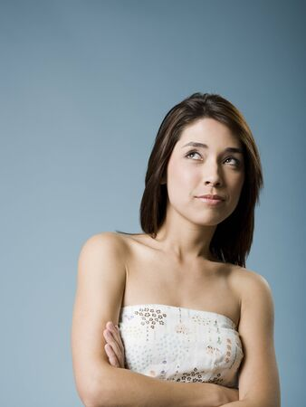 Woman With Arms Crossed Looking Up