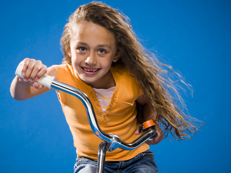 Girl Riding Bicycle And Smiling LANG_EVOIMAGES
