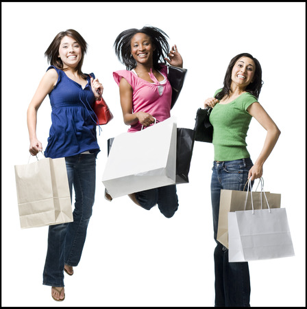 Three Women With Shopping Bags Smiling And Leaping LANG_EVOIMAGES