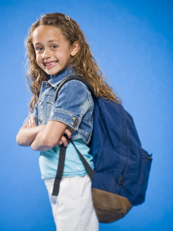 Smiling Girl With Arms Crossed And Backpack LANG_EVOIMAGES