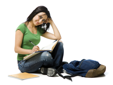 Woman Sitting Cross Legged With Backpack Doing Homework