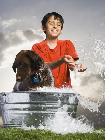 Boy Bathing Dog Outdoors Smiling LANG_EVOIMAGES