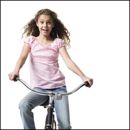 Girl Riding Bicycle Smiling