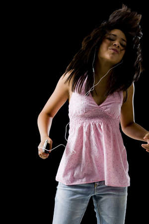 mp3 player: Woman With Mp3 Player Dancing And Smiling LANG_EVOIMAGES