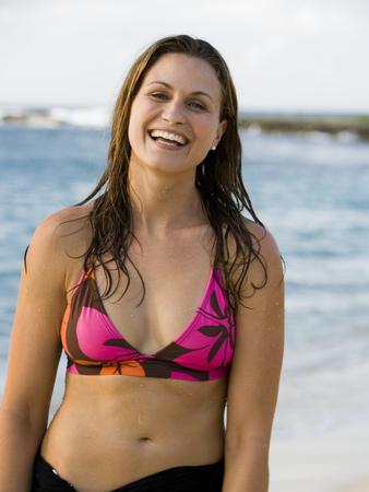 Woman In Bikini And Wrap On Sandy Beach Smiling