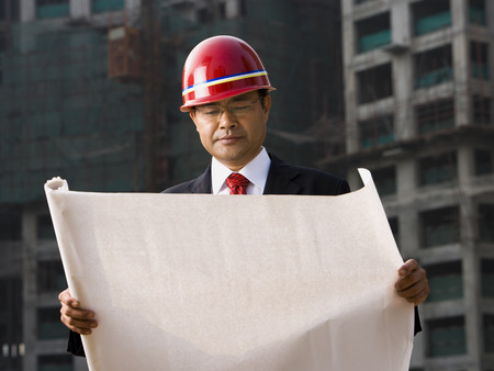 Construction Site Foreman With Blueprints Outdoors LANG_EVOIMAGES