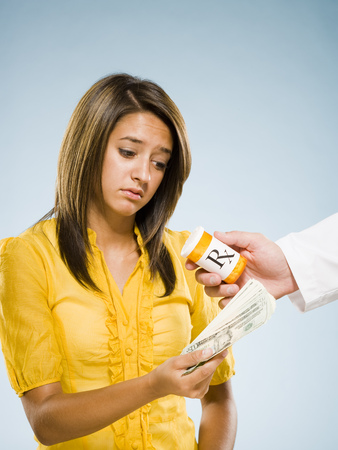 Woman Paying For Prescription