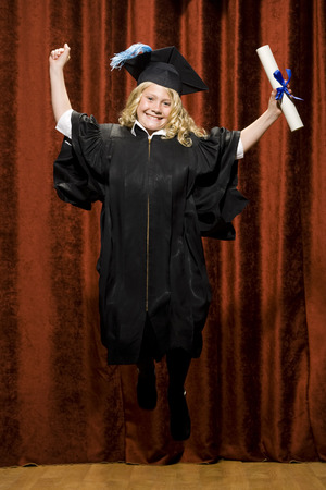 Girl Graduate With Mortar Board And Diploma Smiling And Cheering