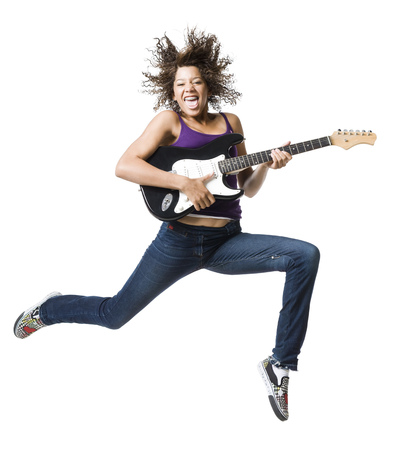 Girl With Braces And Guitar Leaping And Sticking Tongue Out LANG_EVOIMAGES