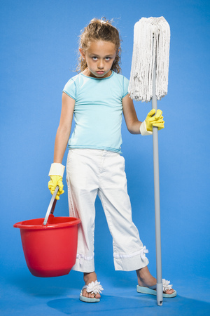 Girl Holding Mop And Bucket With Rubber Gloves