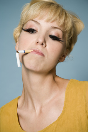Woman With A Broken Cigarette In Her Mouth