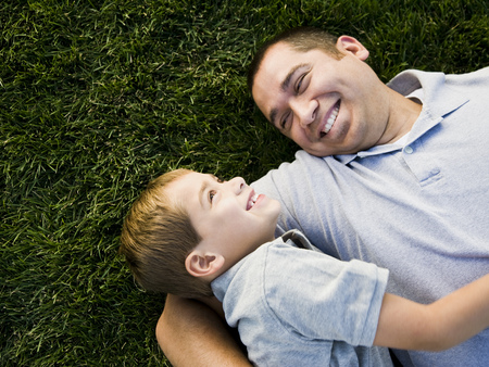 mexican ethnicity: Dad And Son Lying On The Grass
