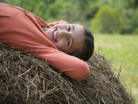Portrait Of A Girl Lying On A Hay Bale