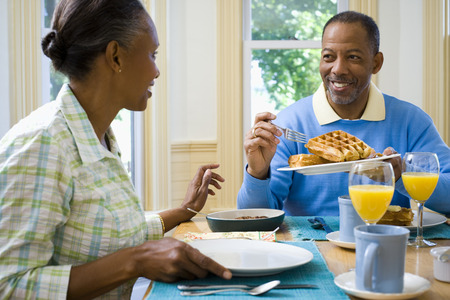 Senior Man And A Senior Woman Having Breakfast LANG_EVOIMAGES