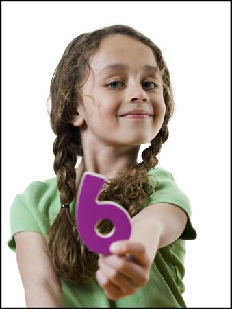 Portrait Of A Girl Holding The Number Six LANG_EVOIMAGES