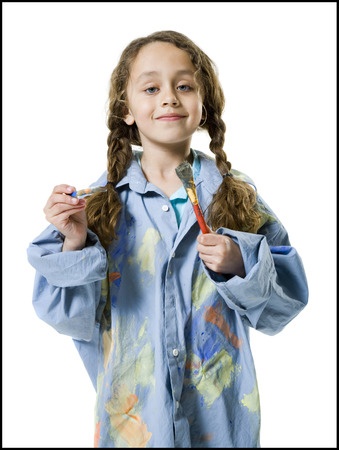 Portrait Of A Girl Holding Two Paintbrushes