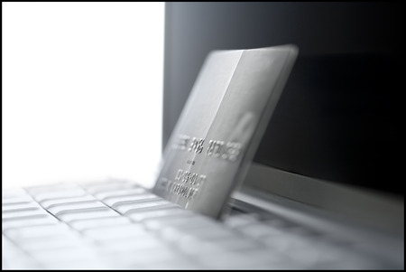 Close-Up Of A Laptop And A Credit Card