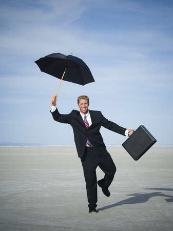 Portrait Of A Businessman Smiling And Holding An Umbrella