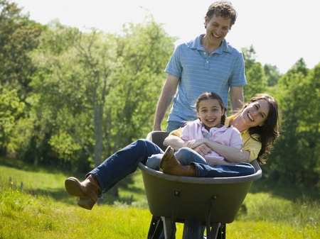 propulsion: Man Pushing His Daughter And His Wife In A Wheelbarrow