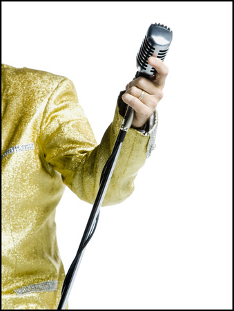 Mid Section View Of An Elvis Impersonator Holding A Microphone