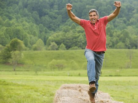 ebullient: Portrait Of A Man Jumping On A Hay Bale