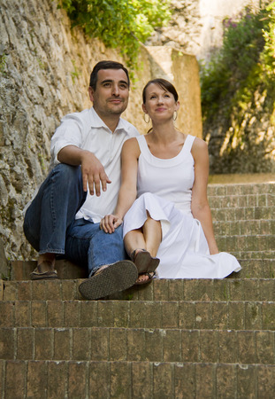 Italy,Ravello,Couple Sitting On Steps In Old Town