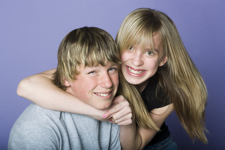 Portrait Of A Teenage Boy And A Teenage Girl Smiling LANG_EVOIMAGES