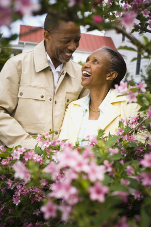 Close-Up Of A Senior Man And A Senior Woman Looking At Each Other LANG_EVOIMAGES