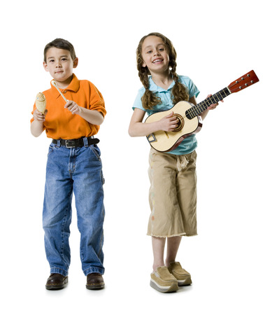 Portrait Of A Girl Playing The Guitar With A Boy Standing Beside Her LANG_EVOIMAGES