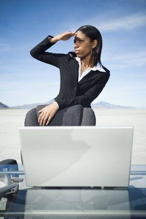 Businesswoman Shielding Her Eyes