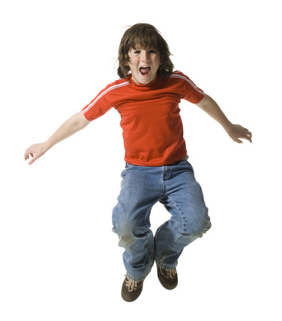 Portrait Of A Boy Jumping In Mid Air LANG_EVOIMAGES