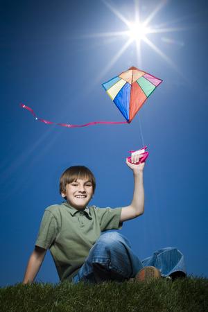 Portrait Of A Boy Flying A Kite