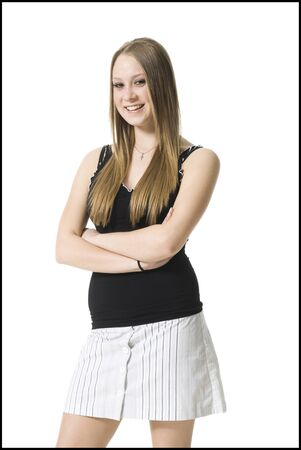 Portrait Of A Teenage Girl Standing With Her Arms Crossed