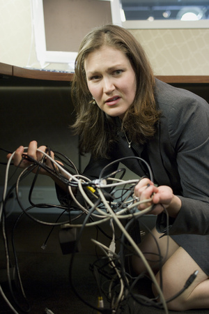 Portrait Of A Businesswoman Holding Tangled Wires
