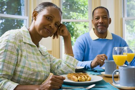 fastened: Portrait Of A Senior Man And A Senior Woman Sitting At The Breakfast Table LANG_EVOIMAGES