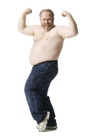 Portrait Of A Mature Man Flexing His Muscles LANG_EVOIMAGES