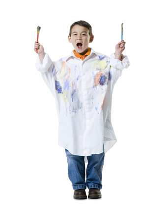 Portrait Of A Boy Holding Two Paintbrushes LANG_EVOIMAGES