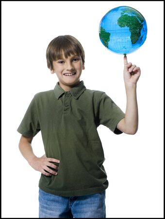 keep your hands: Portrait Of A Boy Touching A Globe LANG_EVOIMAGES
