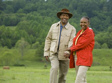 Portrait Of A Senior Man And A Senior Woman Walking In A Field