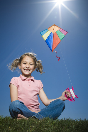 Portrait Of A Girl Flying A Kite