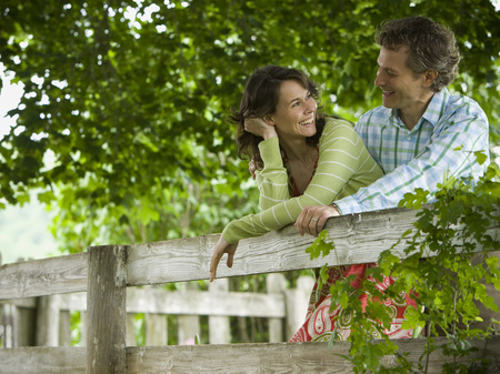 chequer: Man And A Woman Leaning On A Wooden Fence